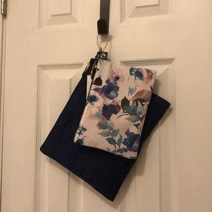 pouches one is navy blue and one has flowers on it